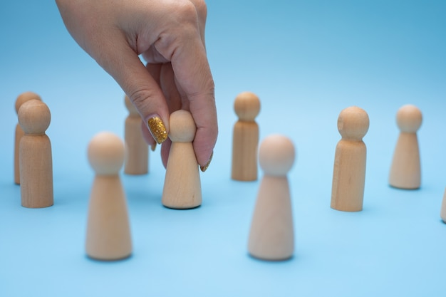 Successful team leader, woman hand choose people standing out from the other.