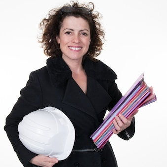 Successful woman engineer holding protection helmet and holding  construction plan