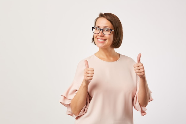Successful woman showing thumbs up