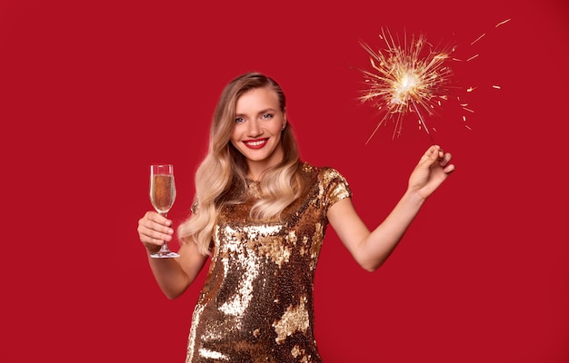 Successful woman with champagne glass and sparkler
