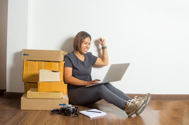 Successful women in online sale idea concept, with working laptop computer