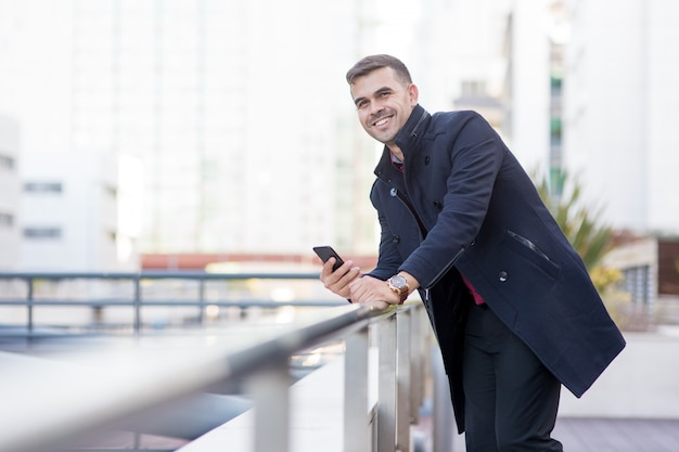 Successful young businessman standing on rooftop