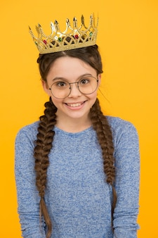 Such an honor for me. little smart girl wear eyeglasses. clever child. cute adorable girl in glasses. excellent pupil. success and happiness. princess concept. girl princess. happy smiling princess.
