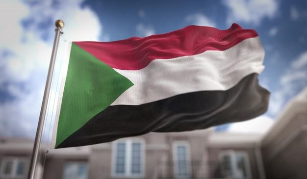 Sudan flag 3d rendering on blue sky building background