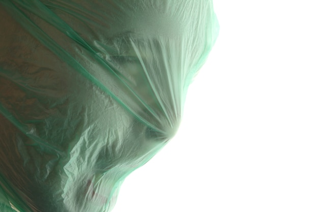 Suffocation. a man with green transparent plastic bag over his head is suffocating.