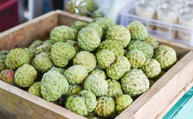 Sugar apple on wooden box in the fruit market asian annona sweetsop or or custard apple
