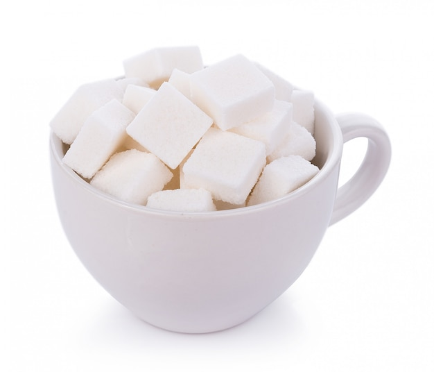 Sugar cube in cup on white