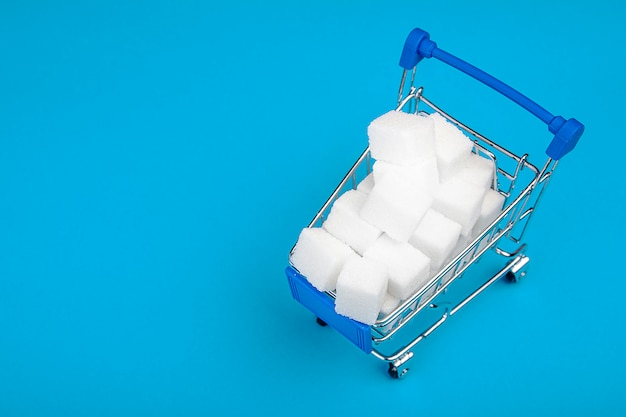 Sugar. cubes of sugar in the shopping cart.