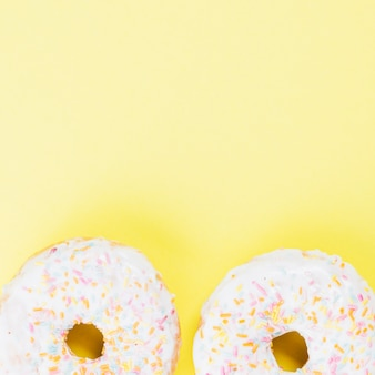 Sugar donuts with white chocolate glaze and sprinkles