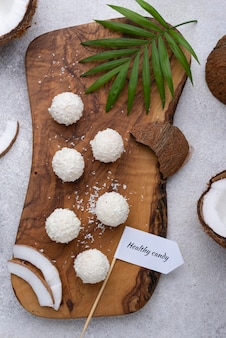 Sugar free coconut candy on wooden board