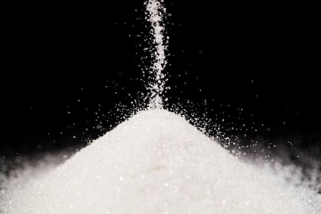 The sugar lies on the black background
