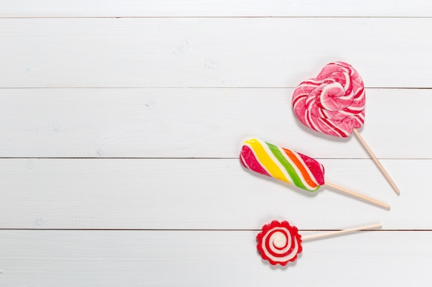 Sugar lollipop on the wooden table  with copyspace