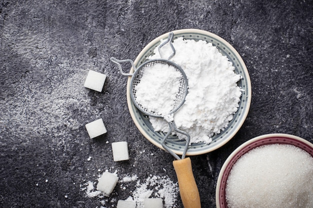 Sugar and powder on concrete background. selective focus