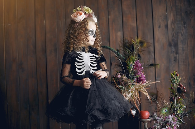 Sugar skull little girl halloween costume and makeup. halloween party. day of the dead.