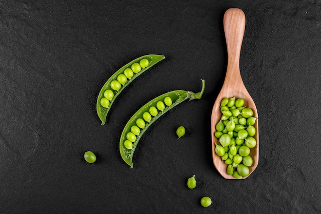 Sugar snap peas with mint on a rustic wood background