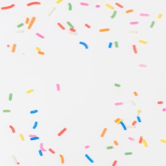 Sugar sprinkles on off white background