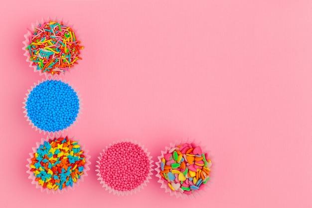 Sugar sprinkles on pink background