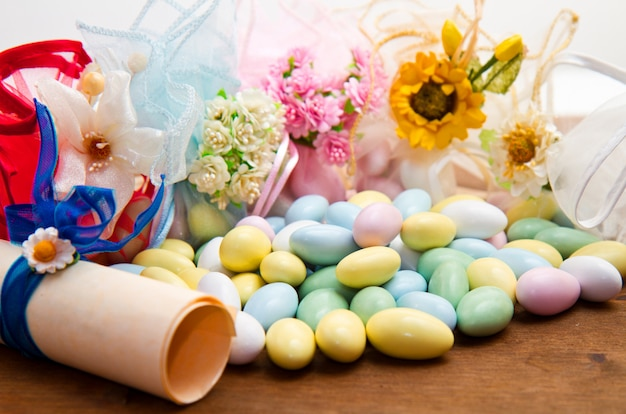 Sugared almonds color blue, rose,  yellow  and white.