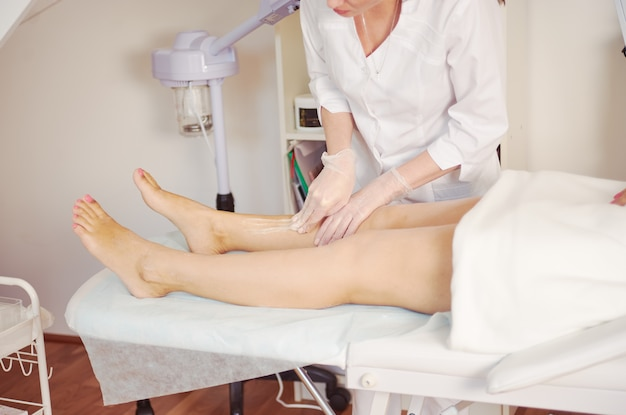 Sugaring depilation in cosmetology salon