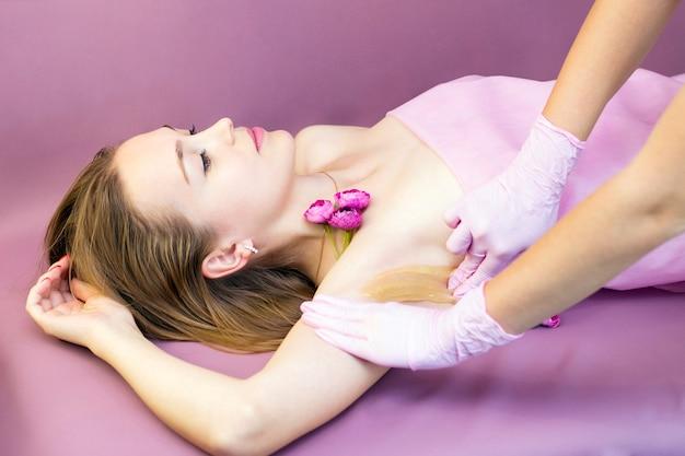 Sugaring epilation with liquate sugar at armpit.