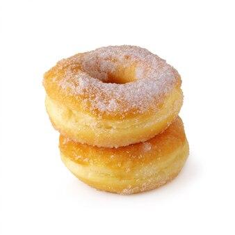 Сладкие пончики, изолированные на белом фоне