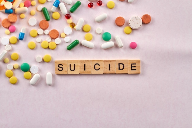 Suicide drugs on white background.