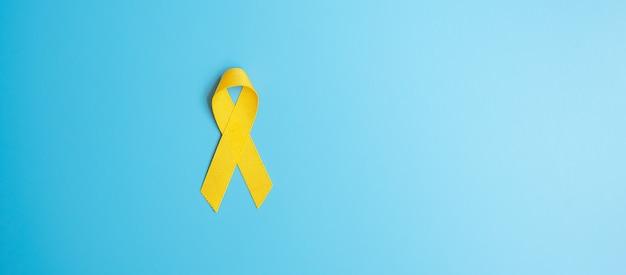Профилактика самоубийств, саркома, кость, мочевой пузырь, месяц осведомленности о детском раке, желтая лента для поддержки людей, живущих и больных. концепция здравоохранения детей и всемирного дня рака