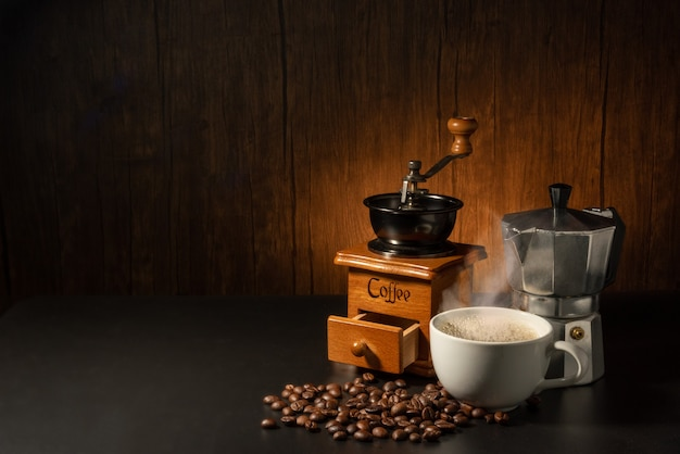 Suit of moka pot, grinder and coffee cup with coffee beans
