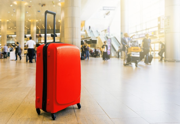 Suitcase in airport airport terminal waiting area with lounge zone