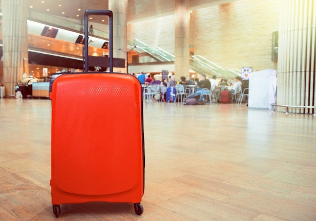 Suitcase in airport terminal waiting area. traveling luggage in airport terminal.