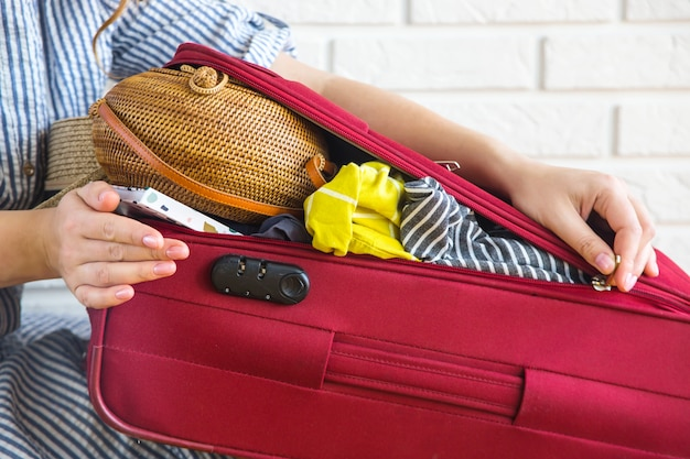 Suitcase full of women's clothing for summer holidays