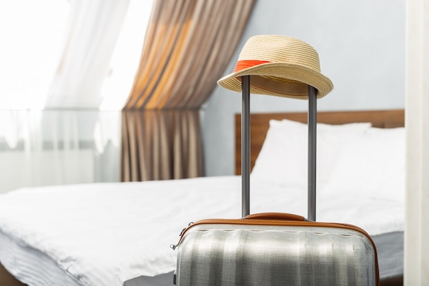 Suitcase in light hotel room
