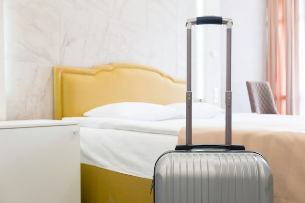 Suitcase or luggage bag in a modern hotel room