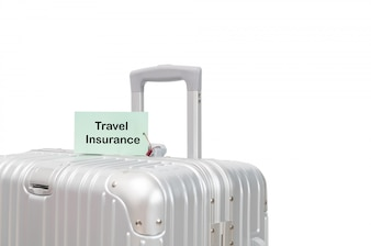 Suitcase with TRAVEL INSURANCE label isolated