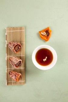 Sujeonggwa - korean punch with cinnamon and dried persimmons.