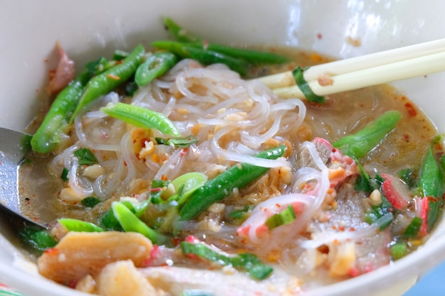 Sukhothai tom yum noodle close up