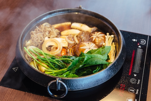 Sukiyaki hot pot with boiling vegetables