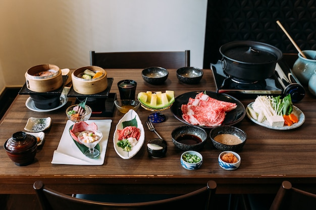 Sukiyaki set including rare slices wagyu a5 beef