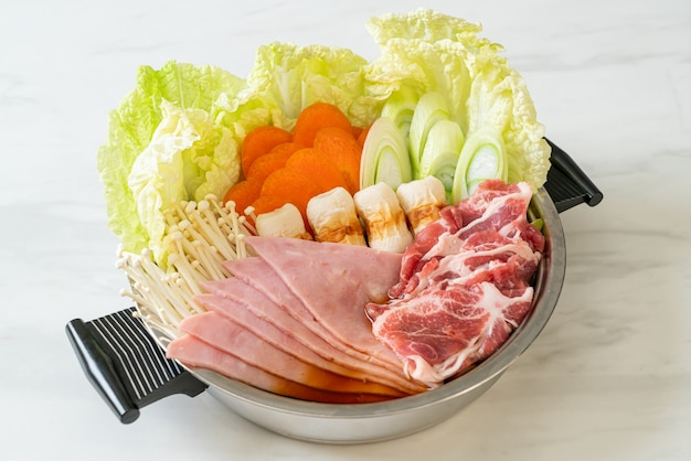 Sukiyaki or shabu hot pot black soup with meat raw and vegetable - japanese food style