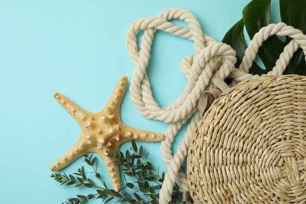Summer accessories on blue isolated background, space for text