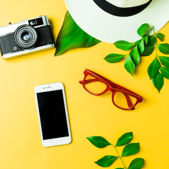 Summer accessories on yellow background
