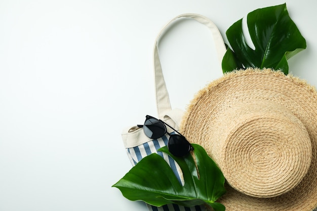 Summer accessories on white isolated background, space for text