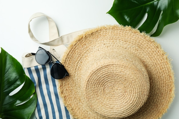 Summer accessories on white isolated background, top view