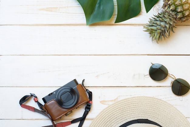 Summer accessories on white wooden  background