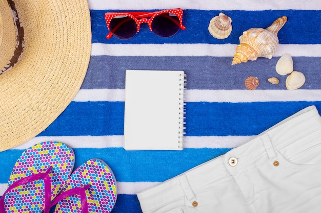 Summer accessories with notebook and copy space.