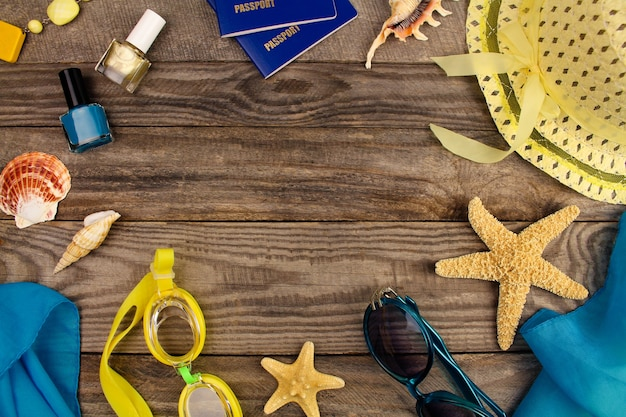 Summer accessories on wooden old background.
