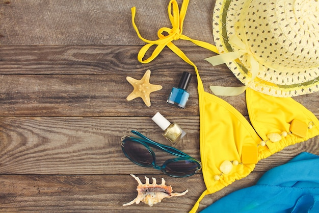 Summer accessories on wooden old background