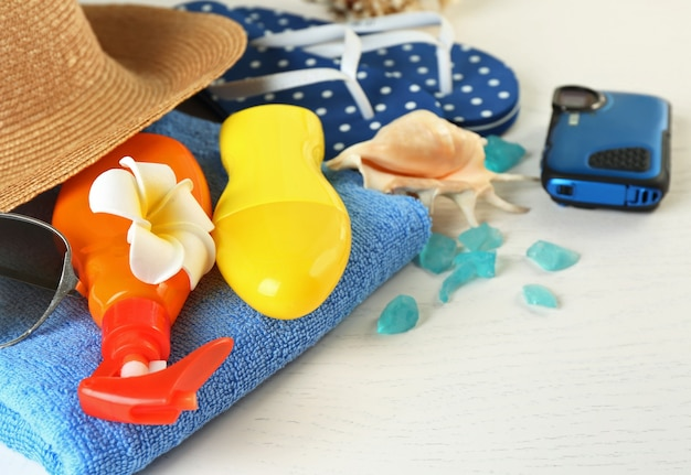 Summer accessories on wooden table, close up