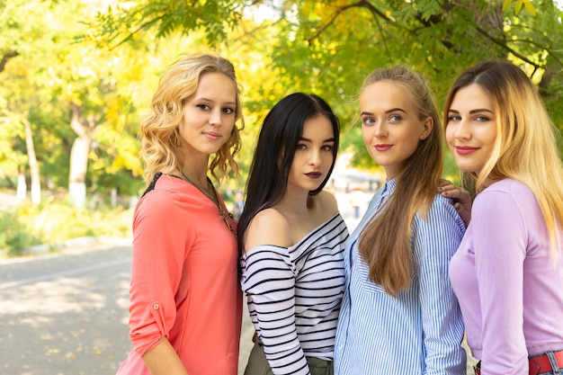 Summer autumn vacation, holidays, travel and people concept - group of young women in the park