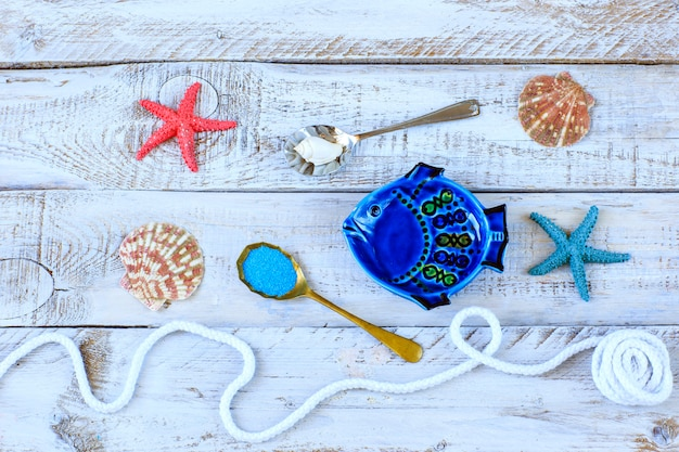 Summer background about leisure and travel: sea, fish, shells, sand, starfish